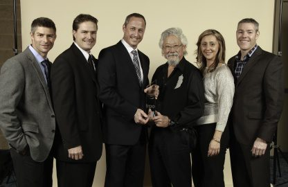 Skyline Owners and managers pose with David Suzuki at an Awards banquet